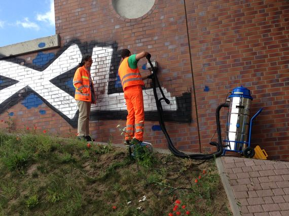removing graffiti professional at a motorway