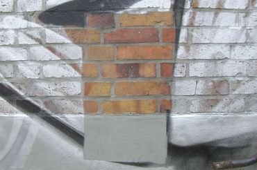 graffiti removal on brick with cleaning machine